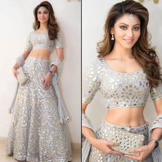 Get this beautiful mirror work lehenga from nivetas design studio. For order booking email Indian Wedding Wear, Indian Party Wear, Indian Attire, Indian Outfits, Red Lehenga, Lehenga Choli, Mirror Work Lehenga, Lehnga Dress, Indian Gowns Dresses