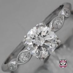 This Certified Platinum Art Deco Engagement Ring is a unique example of 1920's craftsmanship at its most aesthetically simplistic. Weighing 3.2g and measuring 6.5mm wide and 5mm deep, this original and passionately sought after Antique Engagement Ring is definitely one of a kind.