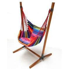 Hammock chair with stand in rainbow colors. The frame is made of bamboo! You can buy online! We send all over the world with Fedex