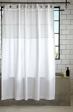 Modern Bathroom With Gray Bathtub White Subway Tile And Billowing Shower Curtain