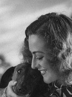 Joan Crawford and Dachshund, 1930s