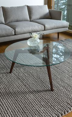 The clear winner. CLARUS walnut and glass coffee table.