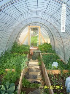 Our hoop house... extending the gardening season year round!