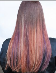 This multicolored color melt by Aveda stylist Erica of MFX Salon in Austin won our Love Your Color contest. We love its many shades of Aveda color, from violet purple to orange to strawberry pink. Formula in comments.