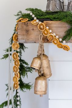 Citrus garland on a fireplace for a rustic farmhouse Christmas look from House of Jade Interiors. #citrusgarland #christmasdecor #swedishchristmas #handmadechristmas
