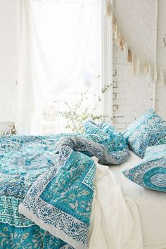 I love this boho comforter. The teal goes great with the otherwise white bedroom. Source unknown, Image found on Tumblr