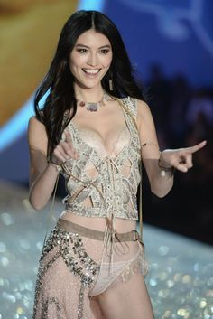 09be6fdbaa Sui He Photos - Model Sui He walks the runway at the 2013 Victoria s Secret  Fashion Show at Lexington Avenue Armory on November 2013 in New York City.