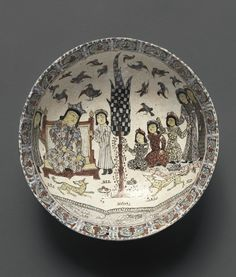 Medium: Ceramic, mina'i (enameled) or haft rangi (seven colors) ware; in-glaze painted in blue, turquoise, and purple on an opaque white glaze, overglaze painted in red and black, with leaf gilding Place Made: Iran Dates: late 12th-early 13th century Dynasty: Seljuq
