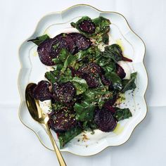 Prettiest when not piled too high; divide the salad over two platters and put one at each end of the table.