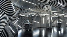 Ministry of Design creates robot training facility lined with metal and lights