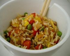 Rainbow fried rice  Serves:  Ingredients     Red - 1/2 red capsicum, diced   Orange - 1 carrot, peeled and diced   Yellow - 1/2 yellow capsicum, diced and 1/2 cup frozen corn   Green - 1/2 cup frozen peas   Blue/Indigo - 1/2 red onion, diced   Violet - 6 rashers short cut bacon, diced   1 cup basmati rice