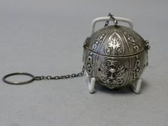 A tea infuser, sometimes called a tea ball or tea egg, was another method of steeping the tea leaves in the pot or cup.