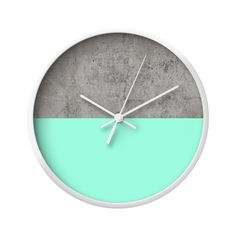 Brighten your day with this Dipped Concrete Wall Clock. Its minimal clock face offers the best of two very different worlds, with a gritty raw concrete top hemisphere and a bright, solid sea green lowe...  Find the Dipped Concrete Wall Clock, as seen in the #SoftSideofMidCentury Collection at http://dotandbo.com/collections/soft-side-of-mcm?utm_source=pinterest&utm_medium=organic&db_sku=122471