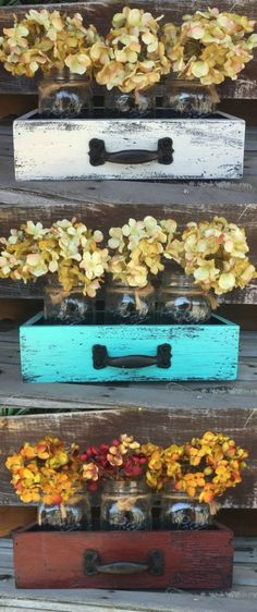 DIY wooden drawers with mason jars, the wood is painted and distressed for a rustic look. Fill mason jars with flowers, candles, or use as wedding decor - love this rustic home decor idea!