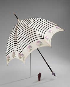 (Photo 1 of 2) 1900-1910 Parasol by Betaille.  This parasol is an example of French artistry as well as an expression of the decorative aspects of the parasol. A custom-made piece, the parasol undoubtedly belonged to a pug owner, given the expensive amethyst pug knob with customized cover.