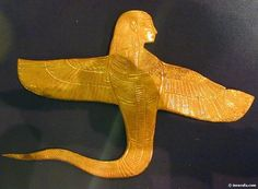 Amulet effigy of Ouret, or Renenutet, winged cobra deity with a woman's head, from Tutankhamun's treasures. Cairo Egyptian museum.