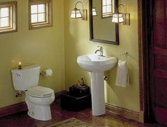 20 Gorgeous Small Bathrooms to Inspire Your Reno: Small Bathroom Ideas - Space-Saving Toilet and Pedestal Sink