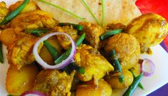 Roti Beef Masala (Sandhia's roti met rundvlees, kousenband en hardgekookte eieren in masala)