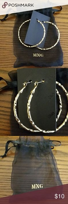 NWT MNG Gold- Toned Hoop Earrings These medium sized hoops add that finishing touch to any outfit. Dress them up or down. NWT, smoke and pet free home. No trades. Comes with original dust bag as shown in picture. Mango Jewelry Earrings
