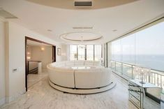 Luxury penthouse large living room with contemporary white furniture