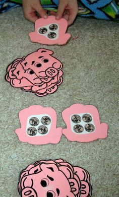 Match the Piggy Bank Game. Simply cut out construction paper in the shape of piggy banks and on the back put different amounts of coins (make two of each). Then let your kids try to match the sets.