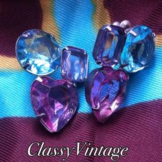 Shimmering earrings. I'm just not sure these are vintage or modem. The metal makes  me think vintage. Pot metal type and round light blue - purple and pink hearts. Pierced. Lucite gems I think. Jewelry Earrings