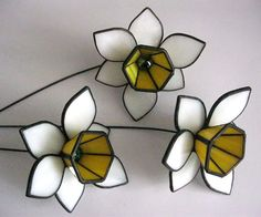 3D daffodils are made of stained glass by Tiffany. The flowers have a strong stem. A bouquet of white flowers will be original decoration for your home and garden. Your daffodils will bloom for years! If you want to send this item as a gift to someone just leave me a note when placing your order, I can add a simple greeting card with your wishes to the package for free. * Price is for 1 flower. Dimensions: Diameter narcissus 11,5m (4,53 in), Stem length 29cm (11,42 in), Weight of a flower…