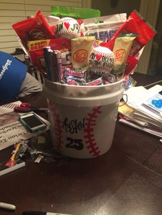 The baseball bucket I did for austin for Valentine's Day! Awesome for the start of the season :] day gift boyfriend day gift girl day gift him day gift ideas day gift kids day gift teacher Baseball Boyfriend Gifts, Baseball Gift Basket, Baseball Buckets, Valentines Gifts For Boyfriend, Baseball Gifts, Boyfriend Anniversary Gifts, Baseball Bags, Baseball Party, Boyfriend Presents