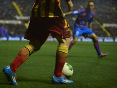 Lionel Messi of Barcelona runs with the ball during the Copa del Rey Quarter Final First Leg match between Levante UD and FC Barcelona at Ciutat de Valencia on January 22, 2014 in Valencia, Spain.