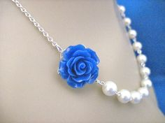 I love this necklace....you can actually pick from a variety of colors for the flower!!!  :)