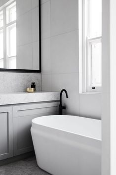 Sleek bathroom combining contemporary and traditional elements