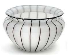 A vase,  Lötz Witwe, Klostermühle c. 1914, pattern No. 157, opalescent white cased glass decorated with seemingly black vertical stripes and applied rim, height 13 cm