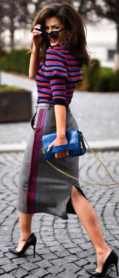 #spring #outfits  woman in black and purple striped shirt and gray skirt walking on road. Pic by @fashion.and.sugar
