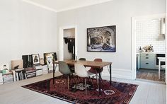 Persian carpet with Eames chairs