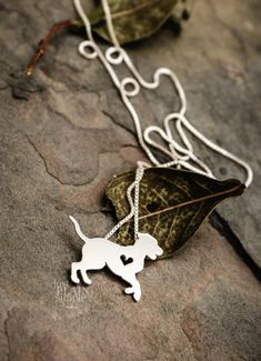 """This tiny Great Dane necklace is a perfectly delicate way to keep a loved pet close to your heart. Just ⅝"""" at its largest dimension, our pendants are made by hand with love. This pendant is cut, soldered, finished, and polished completely by hand. It comes with our beautifully"""