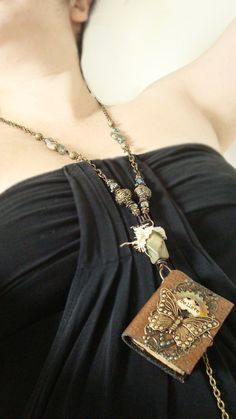 Love love love...  I Believe  Wearable Book Mixed Media Necklace by AlteredAlchemy, $66.00