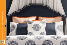 Navy linen upholstered #headboard with gold nail head accents and coordinating mix-and-match #bedding with banding details. #rowleycompany #rowleyroomscapes #fabricating
