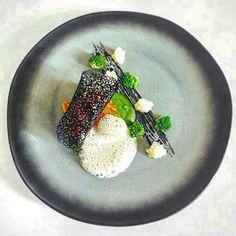 """""""Pan fried cod with chili oil broccoli & anchovy pureé horseradish foam squid ink tuile""""  A plate from @myfrenchchef The first chef we featured on Tastefully Artistic. Thanks for producing amazing plates like this one. . by tastefullyartistic"""