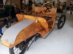 Restored 1923 Morgan de Luxe woodwork varnished and mounted on 2 speed chassis of the time, with a single band brake