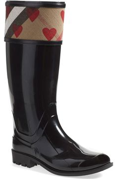 How cute are these puddle-proof Burberry rain boots with the signature check print and hearts?