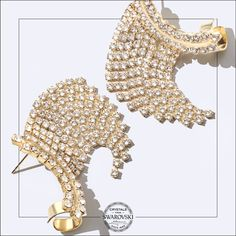 According to Greek accessories brand Dimitriadis, life is too short to wear boring jewelry—which is the perfect rationale for including plenty of Swarovski crystals and pearls in its pieces. These earrings incorporate 228 Xirius Chatons set in a mesmerizing fan motif in gold-plated bronze.