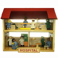 """This set includes a sturdy play hospital and 27 hospital accessories. The hospital has a lift-off roof, removable second story and slide out interior walls. It measures 20"""" long, 12"""" wide, and 16.5 inches high.    The 27 piece hospital set includes 8 wooden posable figures: 2 surgeons, 4 patients (one with leg wrap), 2 doctors and a nurse along with hospital beds, surgery table, IV stand, pharmacy kiosk, and even a wheelchair.  Figures measure about 4"""" tall."""