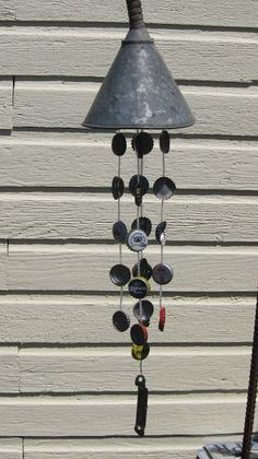 13 Crafty DIY Wind Chimes • Lots of Ideas and Tutorials! Including from 'from the alley to the gallery', this bottle cap wind chime.