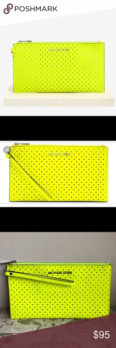 Michael Kors Jet Set Perforated Travel Clutch Rare find! Purchased over five years ago! Absolutely love this shade of neon yellow. I rarely have places to go and when I do, I use a large bag for my toddler. This clutch is the larger size, and fits an iPhone plus easily along with lipsticks, etc. There is a small card/cash compartment on the side. No scuffs or marks. Rarely used. Some scratches may be visible on hardware but in EUC. KORS Michael Kors Bags Clutches & Wristlets