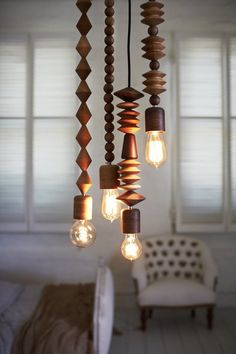 "Beaded Hanging Lamp - Buy a hanging lamp kit from the hardware store or IKEA. Use wood beads (natural, stain or paint them) with 1/2"" hole or drill hole so they slide onto the cord easily. Cut off the plug and thread beads onto the cord to your liking. Rewire the plug and hang from ceiling using a hook. What an awesome lamp!"