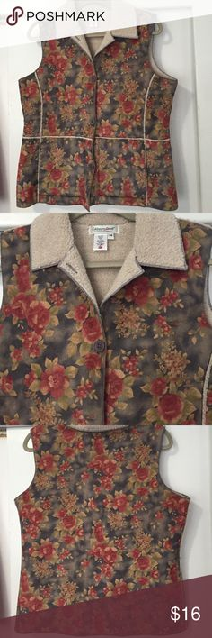 Cold water Creek Vest This unique vest is polyester but feels like a shammy. The inside is a berber of polyester and acrylic. It is lightweight but very warm. The flower print in muted green is lovely. You will love it and just wait for the compliments. It is in new never worn condition. Coldwater Creek Jackets & Coats Vests