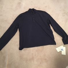 Calvin Klein long sleeve button down shirt Never worn with tags navy blue MENS shirt 💙has 4 black buttons on top! Any questions just ask 💙 Tops Tees - Long Sleeve