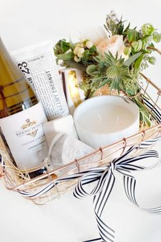 How to Spruce Up Your Wine Gift with @kjwines || DIY gift basket: candle, mini bouquet, wine, hand cream, matches, soap and exfoliator
