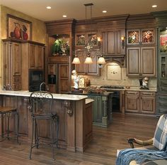 Dark Glazed cabinets- kitchen cabinet color. Would style it more farmhouse less tuscan.