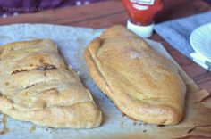 Whole Wheat & Spelt Calzone: 1.5 cups whole wheat flour 1 cup Spelt flour 1/2 cup All purpose flour 1 & 1/4 water + 1/4 cup more (or as required) 1 tsp instant yeast  a pinch of sugar 2 tbsp olive oil  ½ tsp salt  2 tbsp of milk + 1 tsp of oil for brushing the calzones